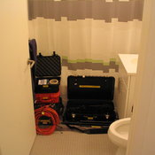 Bathroom filled with equipment cases