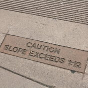 Caution: Slope Exceeds 1:12