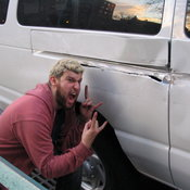 Adam shows off what he managed to do to the rental van.